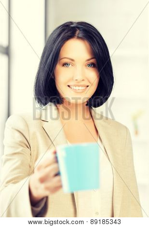 bright picture of lovely businesswoman with mug.
