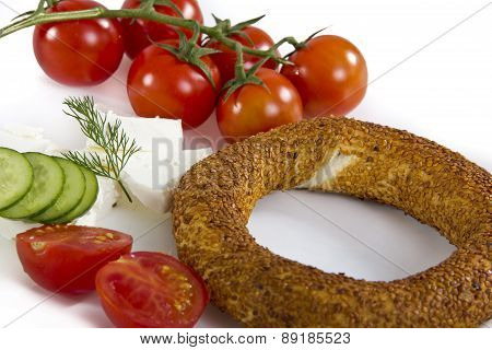 Mediterranean breakfast bagel with cheese tomatoe and cucumber simit isolated on white background
