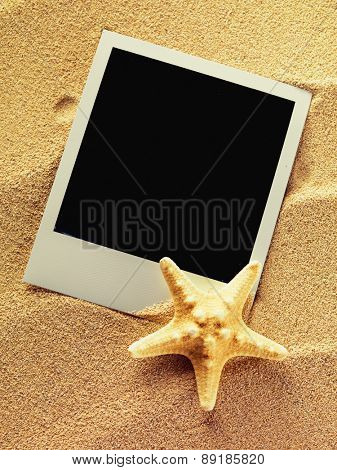 Summer like vintage style empty  photo cards lying on a sea sand decorated with starfish. Sunny summer background. Space for your text.