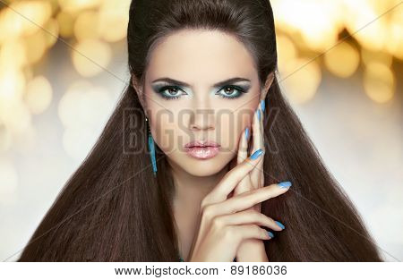Beautiful Model Brunette With Makeup, Long Hair. Manicured Nails. Hairstyle. Fashion Girl Over Light