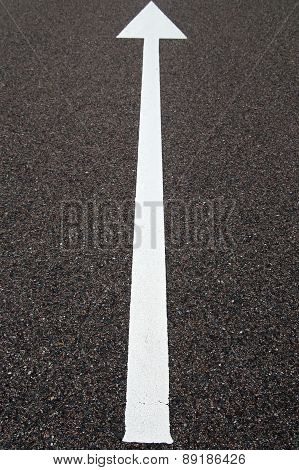 Direction arrow on asphalt
