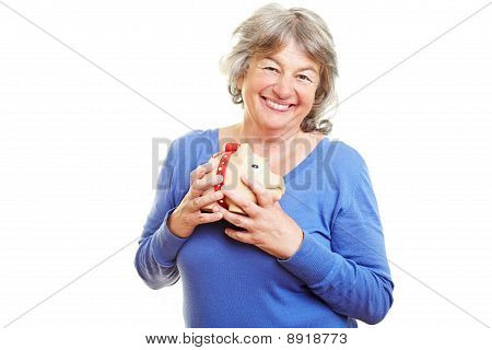 Senior Woman Holding Piggy Bank