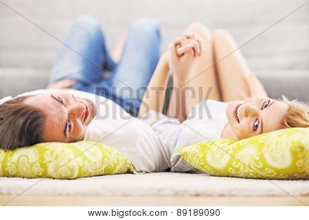 A picture of a young couple relaxing at home