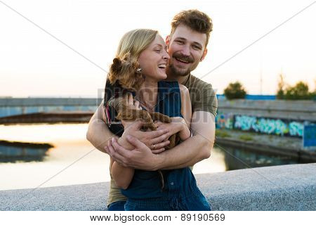 Happy Hansome Young Couple With Small Dog