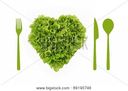 heart shaped salad lettuce whit cutlery over white background