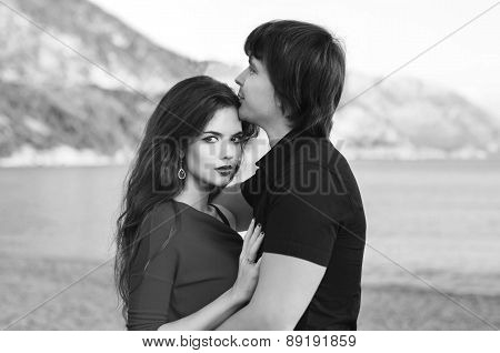 Outdoor Portrait Of Happy Couple In Love. Romantic. Black And White Photo.