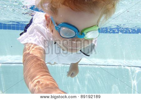 Child Swimming In Pool Underwater