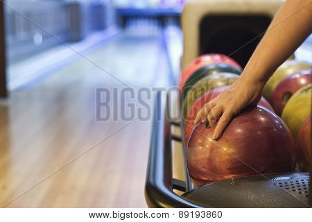 colorful bowling balls in front of tenpin alley