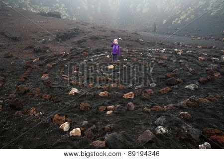 Child Standing In Spiritual Spiral In Etna Volcano Crater