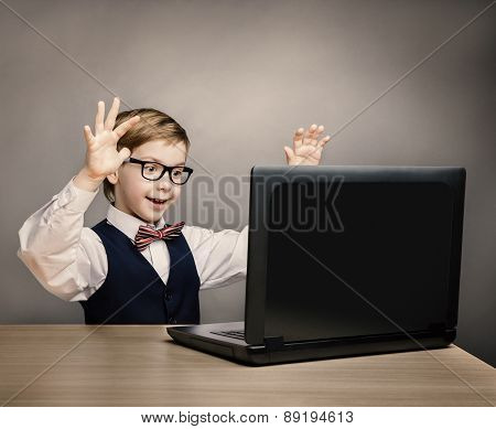 Child With Laptop, Little Boy In Glasses Happy Amazed Looking At Computer, School Kid