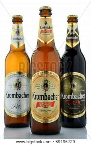 Variety of Krombacher beer isolated on white background.