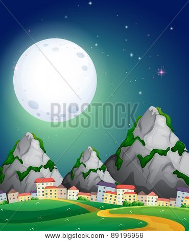 View of fullmoon over the village in the countryside
