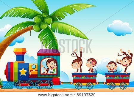 Monkeys riding a train through a beach