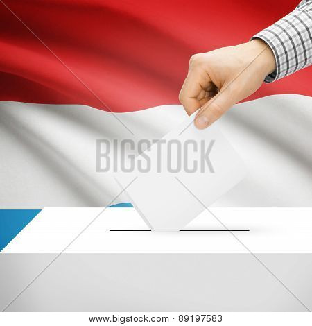 Voting Concept - Ballot Box With National Flag On Background - Luxembourg