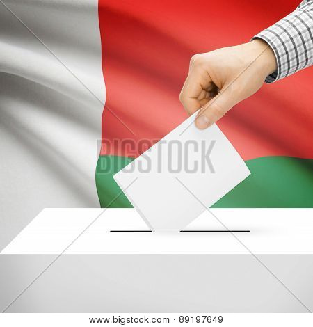 Voting Concept - Ballot Box With National Flag On Background - Madagascar