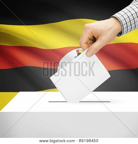 Voting Concept - Ballot Box With National Flag On Background - Uganda