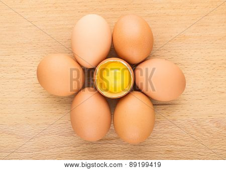 Several Chicken Eggs On Board And One Broken Egg
