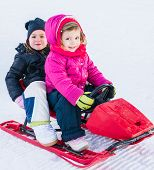foto of toboggan  - girls having fun riding on fast toboggan - JPG
