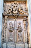 foto of pilaster  - carved wooden portal of an italian church - JPG