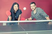 pic of ping pong  - couple playing ping pong in a bar - JPG