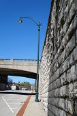 image of illinois  - A lamppost next to a high wall - JPG