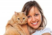 stock photo of young woman posing the camera  - Young woman posing at camera with redhaired domestic cat - JPG