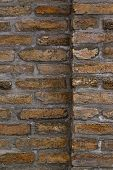 stock photo of brick block  - Vertical background pattern of weathered old brick wall texture grungy rusty brushed blocks as urban architecture backdrop - JPG