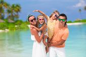 stock photo of children beach  - Happy beautiful family on a beach during summer vacation - JPG