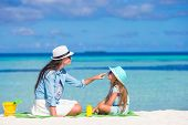 pic of sun tan lotion  - Young mother applying sun cream on her kid - JPG