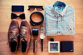 picture of no clothes  - Top view of clothing and diverse personal accessory laying on the wooden grain - JPG
