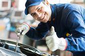 stock photo of car repair shop  - Mechanic repairing a car - JPG