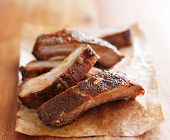 pic of cutting board  - pile of barbecue spare ribs on cutting board - JPG