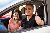 Постер, плакат: Man And Wife Driving Their Car