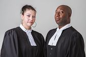 stock photo of toga  - caucasion woman and black man wearing canadian lawyer toga - JPG