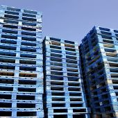 foto of pallet  - a lot of blue pallets in sunshine with blue sky - JPG