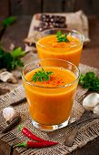 stock photo of lenten  - Delicious cream of pumpkin soup in a glass on wooden table  - JPG