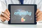 image of empathy  - The word empathy and autism awareness heart against medical biology interface in black - JPG