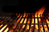 foto of braai  - Empty Hot Charcoal Grill With Flames Of Fire On Black Background Closeup - JPG