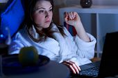 stock photo of night gown  - Girl addicted to social media using laptop at night - JPG
