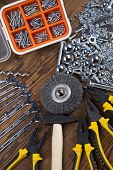 foto of triplets  - Working tools on wooden background - JPG