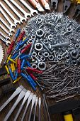 image of triplets  - Assorted work tools on wood background - JPG