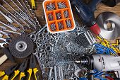 stock photo of triplets  - Assorted work tools on wood background - JPG