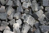 foto of cobblestone  - pile of cobblestones stacked waiting to be used to pave a road