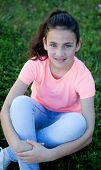 image of  preteen girls  - Beautiful preteen girl with blue eyes sitting on the grass - JPG