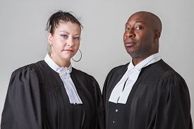 foto of toga  - caucasion woman and black man wearing canadian lawyer toga - JPG