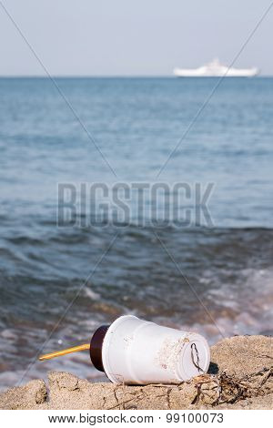 Plastic Coffee Cup On The Beach