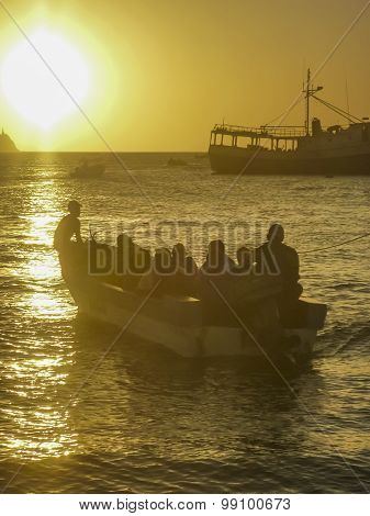 People In Boats At The Sunset In Taganga Bay Colombia