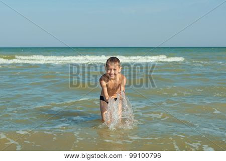 Happy  Children - Boy Having Fun On The Beach