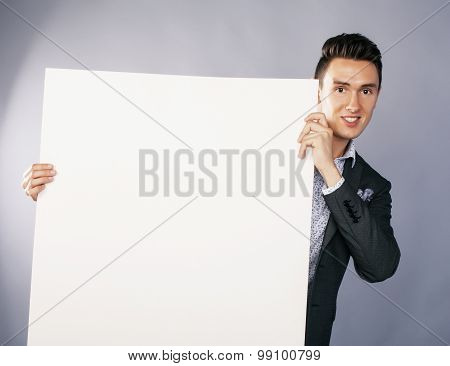 young handsom businessman in suit with poster empty copy space