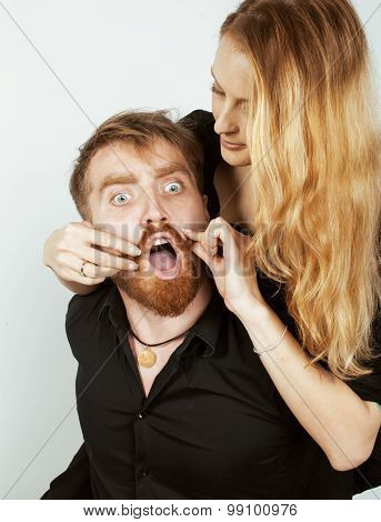 young hipster couple fooling around on white background